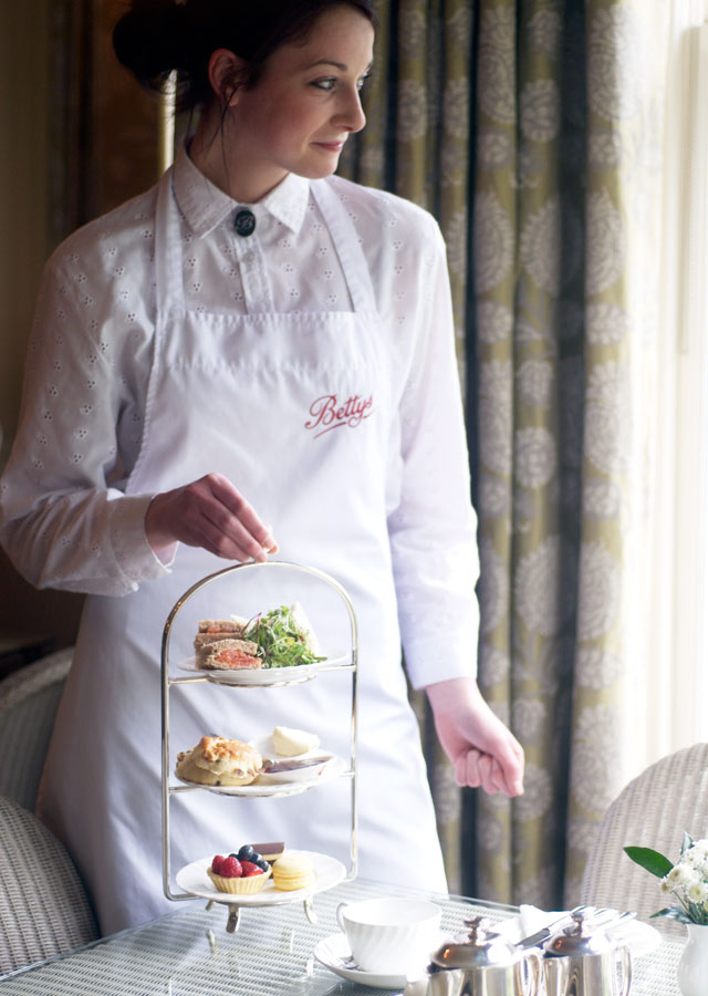 Waitress at Betty's serving afternoon tea