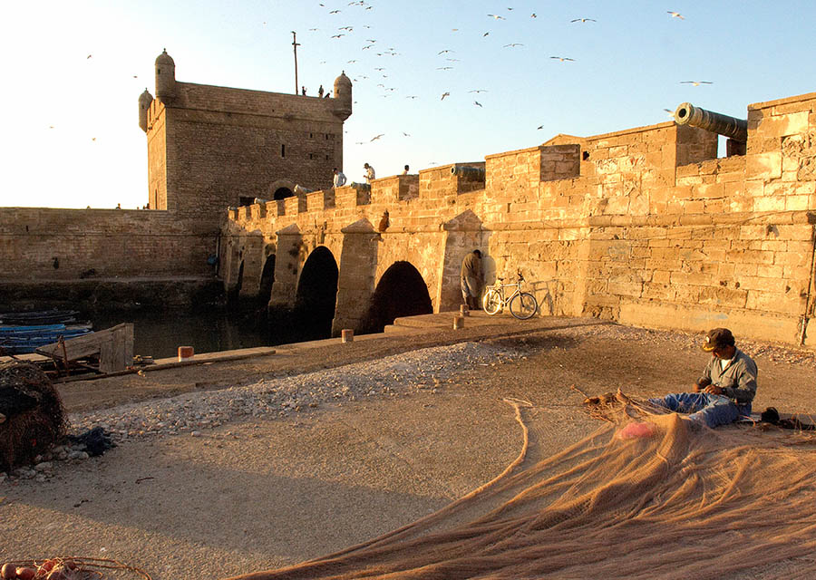 Fisherman repairing a net Essouira Morocco
